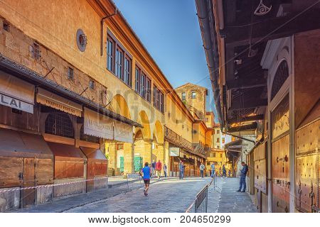 Florence, Italy- May 14, 2017 : Ponte Vecchio Is A Bridge In Florence, Located At The Narrowest Poin