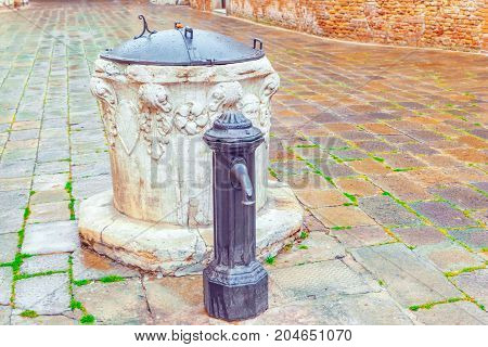 Water Intake Facilities Medieval Venetian Wells In The City Squares. Venice.  Italy.