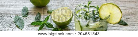 Banner Of Mojito Cocktail With Lime And Mint In Highball Glass On A White Wooden Background