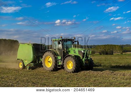 Tractor With Machinery For Making Bales Of Hay
