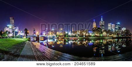Panorama view of a beautiful view of docklands and The Princes Bridge with a cloudy sky and twilight in Melbourne Australia.
