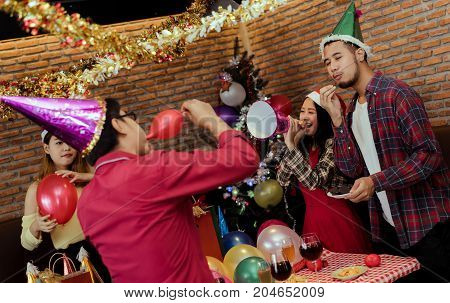 Young men and women group christmas party together with dancing drinking wine happy and fun in new year celebrate