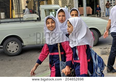 Fars Province Shiraz Iran - 18 april 2017: Iranian girls in school uniform on a city street.