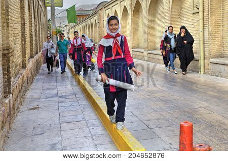 Fars Province Shiraz Iran - 18 april 2017: Iranian schoolgirl in uniform goes home after school.
