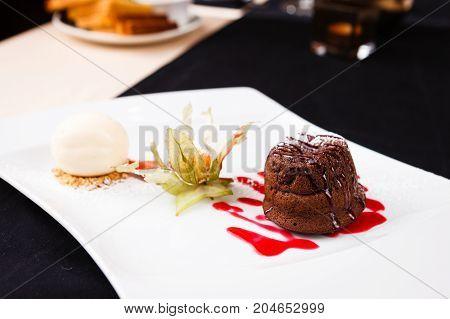 Chocolate fondant with vanilla ice cream and raspberry sauce