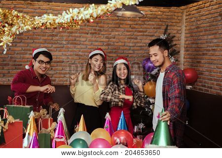Young men and women group christmas party together with dancing happy and fun in new year celebrate