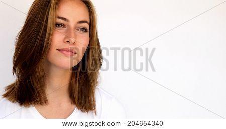 Brunette and beautiful woman looking away in studio