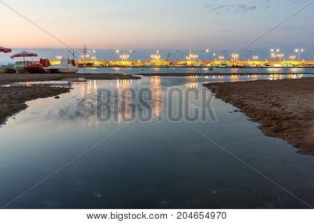 CHERNOMORETS, BULGARIA - AUGUST 14, 2017: Night seascape of port and beach of Chernomorets, Burgas region, Bulgaria