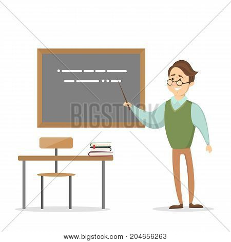 Male techer at class with desk and chalkboard.