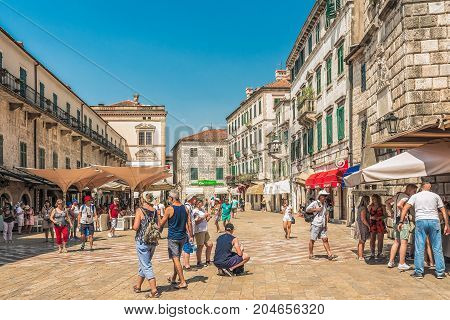 KOTOR, MONTENEGRO - AUGUST 24, 2017: View of the Arms Square in the Old Town of Kotor. Kotor is a city on the coast of Montenegro and is located in Kotor Bay.