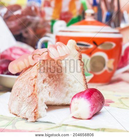 Original false teeth white bread and radishes