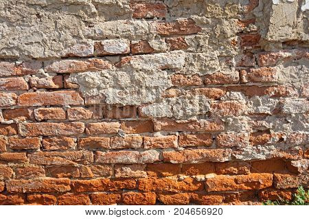 Old ruined brick wall of a building