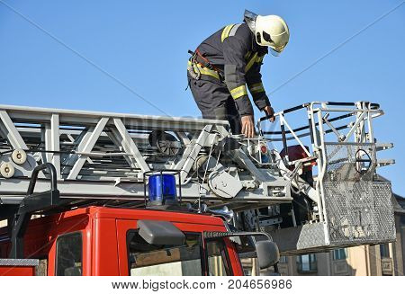 Firefighter on the top of a fire truck