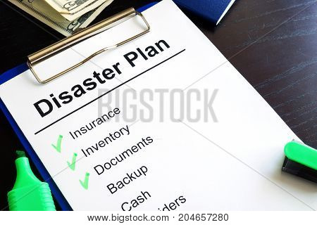 Disaster Plan  and marker on a table.
