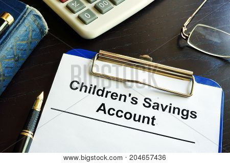 Children's savings account form in a clipboard.