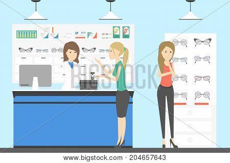 People at eyeglasses store. Checking vision and choosing glasses.