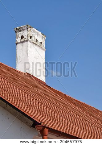 Smoke stack on the roof of a house