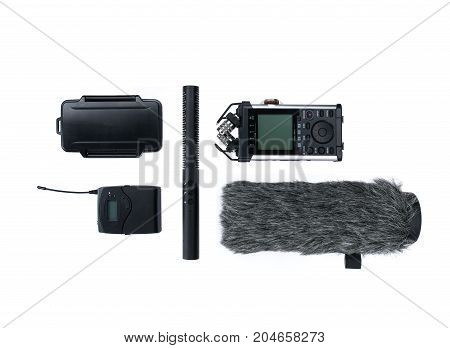 Compisition with field audio recorder card case windsheild and shotgun microphone on the white background