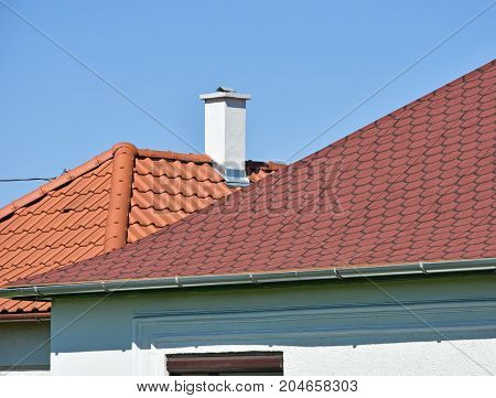 Shingles and roof tiles against blue sky