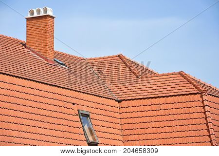 Roof tiles and smoke stack of a building
