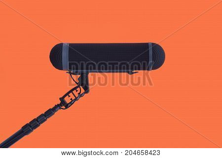 Sound recorder microphone boom mic on red background