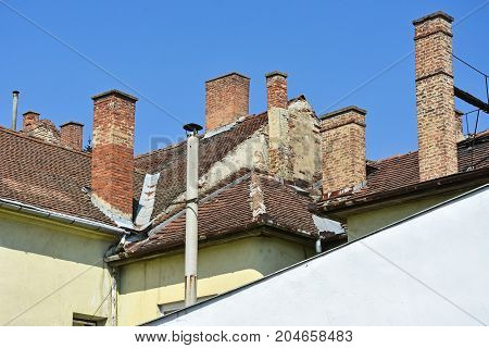 Smoke stacks on the roofs of old buildings