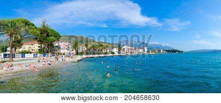 TIVAT MONTENEGRO - SEPTEMBER 10 2017: Unknown people rest on beach of popular resort town of Tivat Montenegro