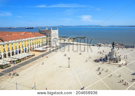 Lisbon, Portugal - August 25, 2017: aerial view from panoramic terrace of Rua Augusta Arch of King Dom Jose I equestrian statues and Tagus River, Praca do Comercio or Commerce Square in Baixa District