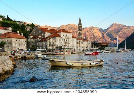 PERAST MONTENEGRO - SEPTEMBER 13 2017: Unknown people walk along promenade of small popular resort town of Perast Montenegro
