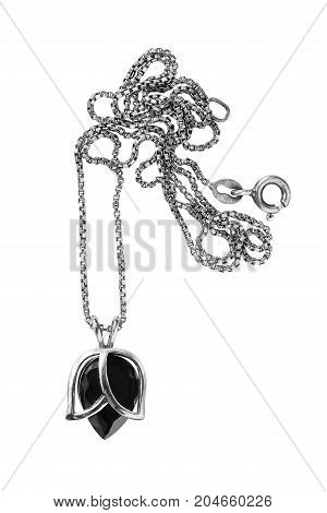 Elegant black crystal pendant on a chain isolated over white