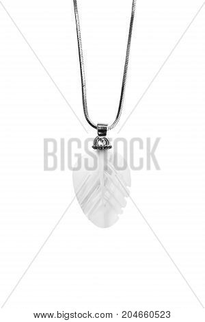 Vintage pearl pendant on silver chain isolated over white