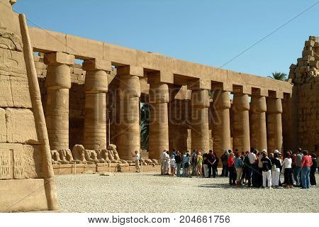 Foreign tourists among the ancient columns of the famous Luxor Temple, Thebes, UNESCO World Heritage Site, Egypt, North Africa, Africa