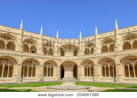 Courtyard or cloisters of Hieronymites Monastery famous Lisbon landmark in Belem district and Unesco Heritage. The Mosteiro dos Jeronimos celebrates the return of Portuguese navigator Vasco da Gama.