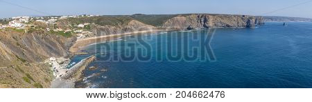 Panorama With Cliffs, Beach And Houses In Arrifana