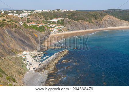 Cliffs, Beach And Houses In Arrifana