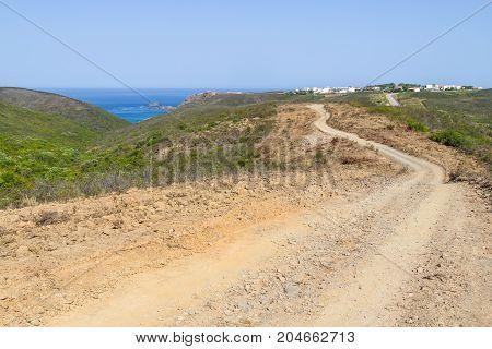 Cliffs, Beach, Trail And Houses In Arrifana