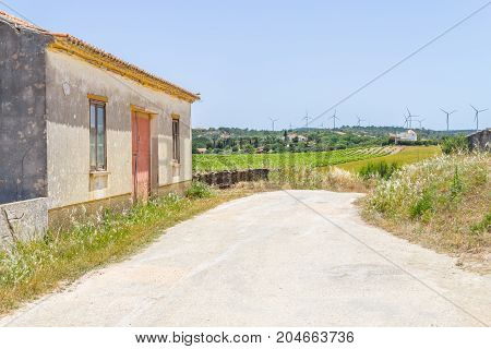 Old Portuguese House, Trail And Wind Farm In The Mountain
