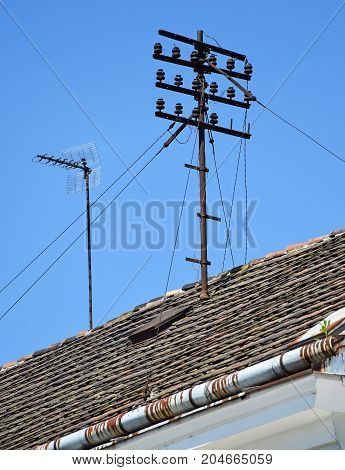 Telephone lines on the roof of a building