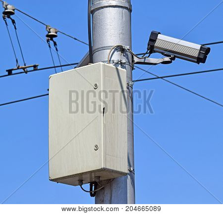 Security camera on the pole on the street