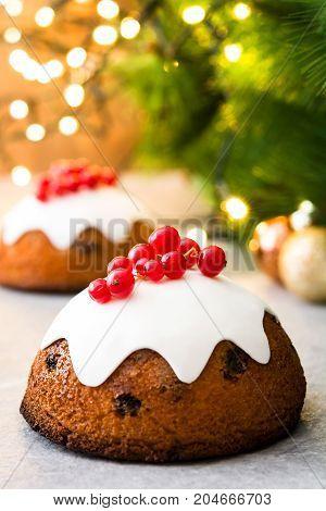Sweet christmas pudding with christmas light background