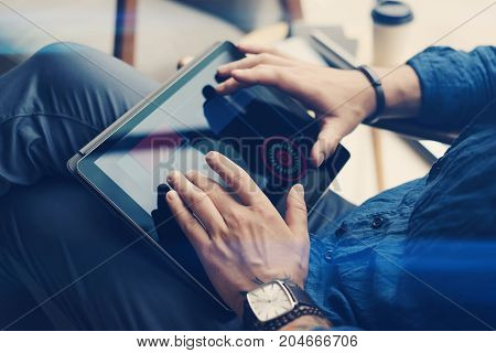Businessman using electronic tablet at office.Man touching tablet screen fingers.Blurred background.Horizontal