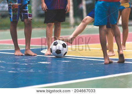 Soccer concept / Boys playing soccer in the gymnasium.