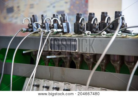 close-up high pressure diesel fuel pump test bench on work