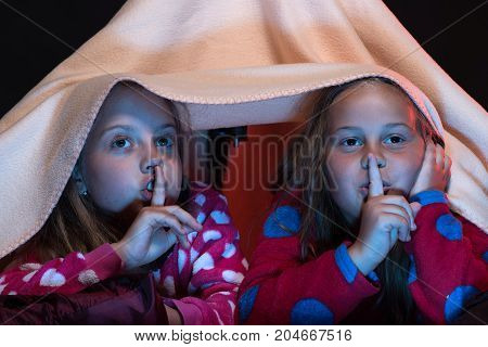 Girls Shushing With Their Fingers On Lips Watching Tv