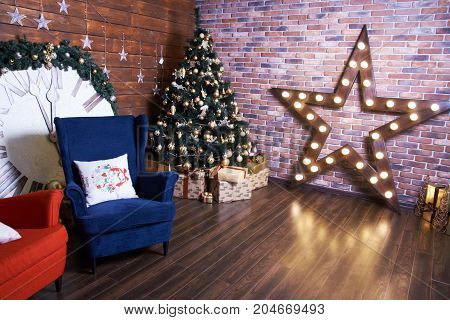 Christmas interior. Beautiful decorations with star and chairs.