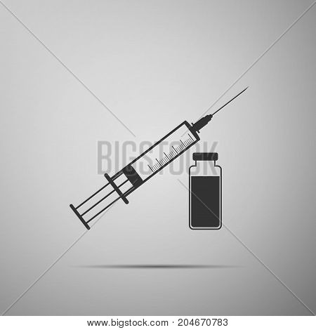 Medical syringe with needle and vial, concept of vaccination, injection icon isolated on grey background. Flat design. Vector Illustration