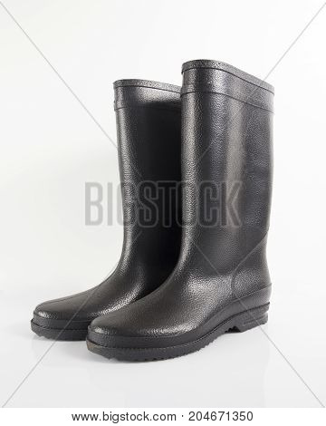 Male Black Rubber Boot on White Background, Isolated Product.