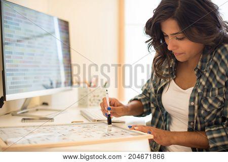 Woman Wrinting On Calendar