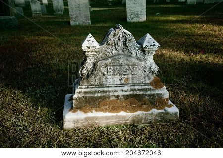 old cemetery in new england an infant's tombstone