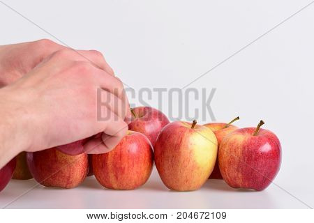 Male Hand Touches Light Red Apples. Fruits In Bright Color